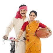 portrait of a couple with bicycle - stock photo