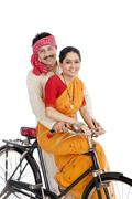 couple riding a bicycle - stock photo