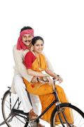 Stock Photo of couple riding a bicycle