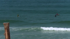 Surfers awaiting in the water - Atlantic Ocean Stock Footage
