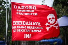 Swiming prohibited red flag - stock photo