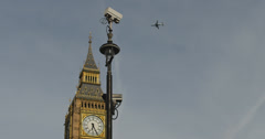 Big Ben, CCTV, plane 4K Stock Footage