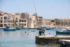 Fisherman fishing in marsaskala, malta Stock Photos
