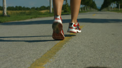 Back view closeup female runner Stock Footage