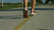 Stock Video Footage of back view closeup female runner