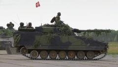 Danish armored fighting vehicles drive in the field Stock Footage