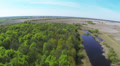 Green wood and field with river .Aerial HD Footage