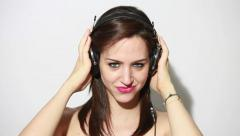 girl wearing headphones, kissing and smiling - stock footage