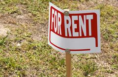 Blank for rent sign on post outside Stock Photos