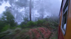 View of the Nuwara Eliya foggy landscape from the moving train. Stock Footage
