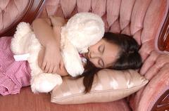 Little girl lying. Stock Photos
