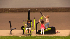 children playing on exercise equipment (STEP) outdoor - stock footage