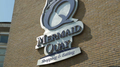 Tourist direction signs, mermaid quay, cardiff bay, wales Stock Footage