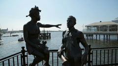 People like us sculpture, immigrant statues, mermaid quay, cardiff bay, wales Stock Footage