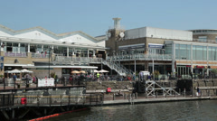 Tourists, shops and restaurants, mermaid quay, cardiff bay, wales Stock Footage