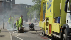 Workmen repair road, highway maintenance, uk Stock Footage