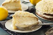 Stock Photo of homemade lemon cake with cream frosting