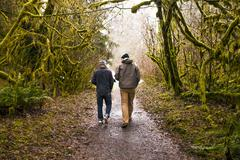 Men walking together in forest Stock Photos