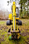 Close up of digger on mossy concrete Stock Photos