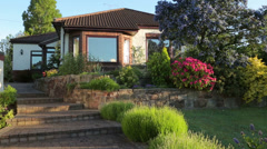 Bungalow, house, and front garden in summer, england Stock Footage