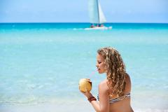 Portrait of woman relaxing with cocktail at cuban beach Stock Photos