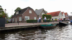 Unknown visitors in the walking in a canal in Giethoorn - stock footage