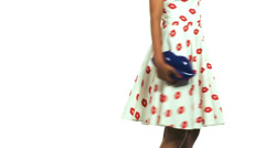 Young black woman wearing a pin-up dress isolated on a white background Stock Footage