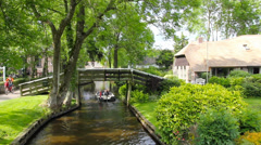 Typical Dutch houses and gardens in Giethoorn, The Netherlands Stock Footage