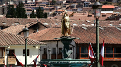 Cusco rooftops and Inca statue c Stock Footage