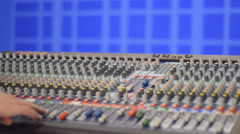 Hand manipulates mixing console Stock Footage