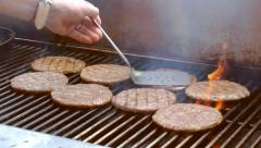 Chef cooking barbecue meat patting burgers with flames Stock Footage