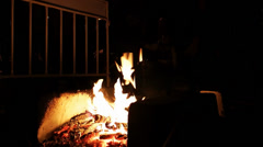 Jumping over the fire at night Stock Footage