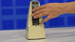 Hand launched metronome - stock footage