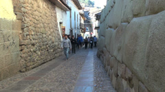 Cusco street with Inca stonework s Stock Footage
