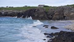 Slow Motion Waves Crashing into Rocks on Shore Stock Footage