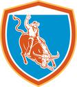 Stock Illustration of rodeo cowboy bull riding shield retro.