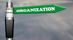 Organization road sign with flowing clouds Stock Footage