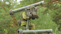 Soldier sits and pointing a missile in the forest, close-up Stock Footage