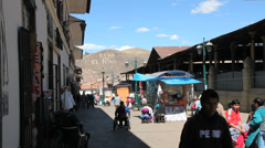 Cusco street with stands c Stock Footage