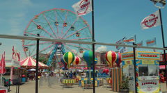 Amusement park ferris wheel at Coney Island Stock Footage
