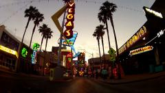 POV Rolling On East Fremont Street Past Neon Art- Las Vegas NV Stock Footage