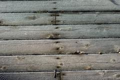 frost crystals on wooden siding - stock photo
