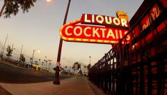 Rolling Down Sidewalk Under Liquor Cocktails Sign- Las Vegas NV - stock footage