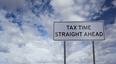 Tax Time Ahead Sign Clouds Timelapse Stock Footage