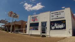 Motorcycle Store Next To Storefront Church- Route 66- Kingman AZ Stock Footage