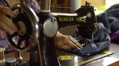 Woman Sewing Jeans on a Vintage Sewing Machine - stock footage