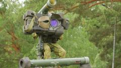 Soldier of Lithuania pointing a missile near the trees, close-up Stock Footage