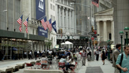 Stock Video Footage of Telephoto Wide Shot of Wall Street and Stock Exchange