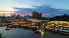 Time lapse movie of Clark Quay in Singapore from Sunset into Blue Hour 1080 Stock Footage