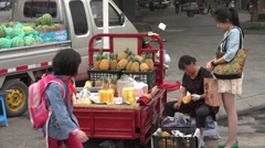 Fruit vendor selling pineapple in Chengdu, China Stock Footage